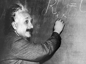 Alber Einstein at the chalkboard